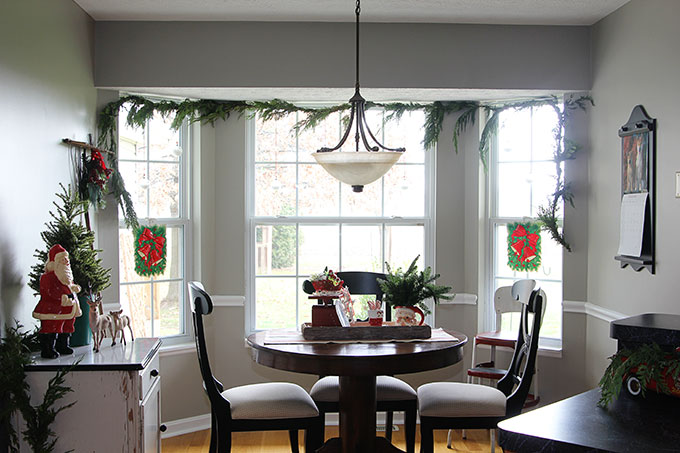 This nostalgic Christmas breakfast room is a great example of how to use vintage Christmas decor in your home without it looking like your grandma's house!