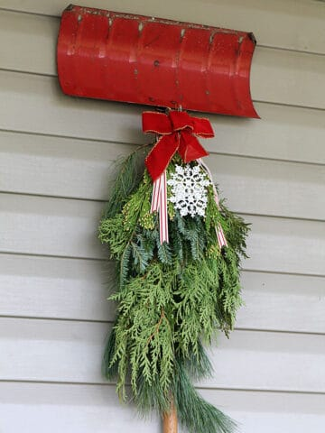 Traditional Christmas porch decor meets FUN and FUNKY! Just because you like a little red and green in your holiday decor doesn't mean it has to be boring.