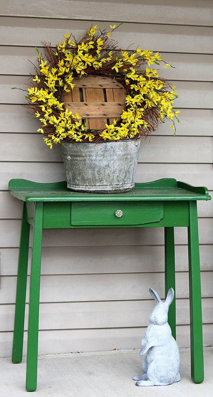 A simple and easy farmhouse spring porch decor idea made with things found in the shed. Truly spring decorating on a budget! #spring #porch #frontporch