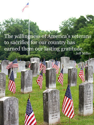 Flags at the cemetery for Memorial Day along with a quote.