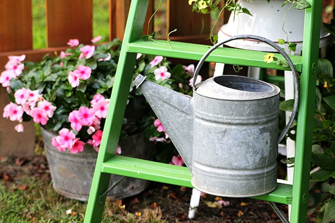 Vintage-Galvanized-Watering-Can-4396Repurpose a vintage tin dollhouse into a birdhouse using this in-depth tutorial. A playful and fun idea for your garden.