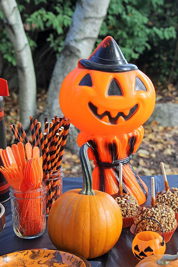 Jack-O-Lantern and cornstalk Empire Plastic blow mold from the 1960's at a traditional Halloween party with orange and black decor including blow molds and vintage inspired Halloween decorations.