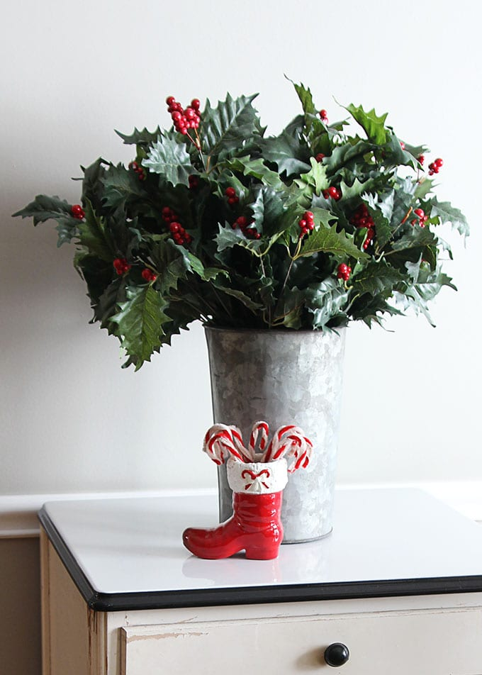 Christmas holly in a galvanized bucket