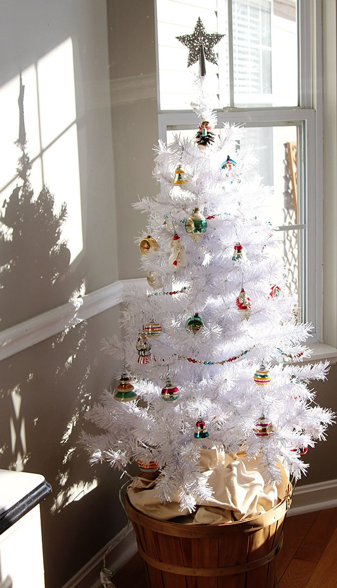 A white Christmas tree with vintage Shiny Brite ornaments