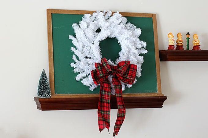 White wreath on a green chalkboard