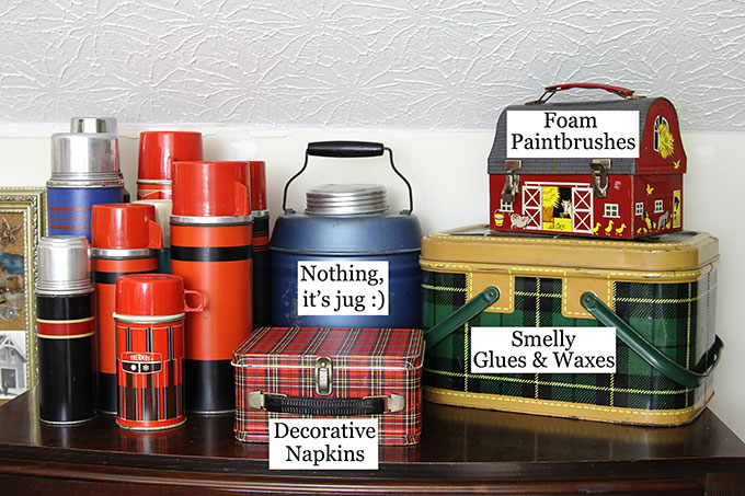 Vintage picnic tins and lunch boxes used to store craft supplies