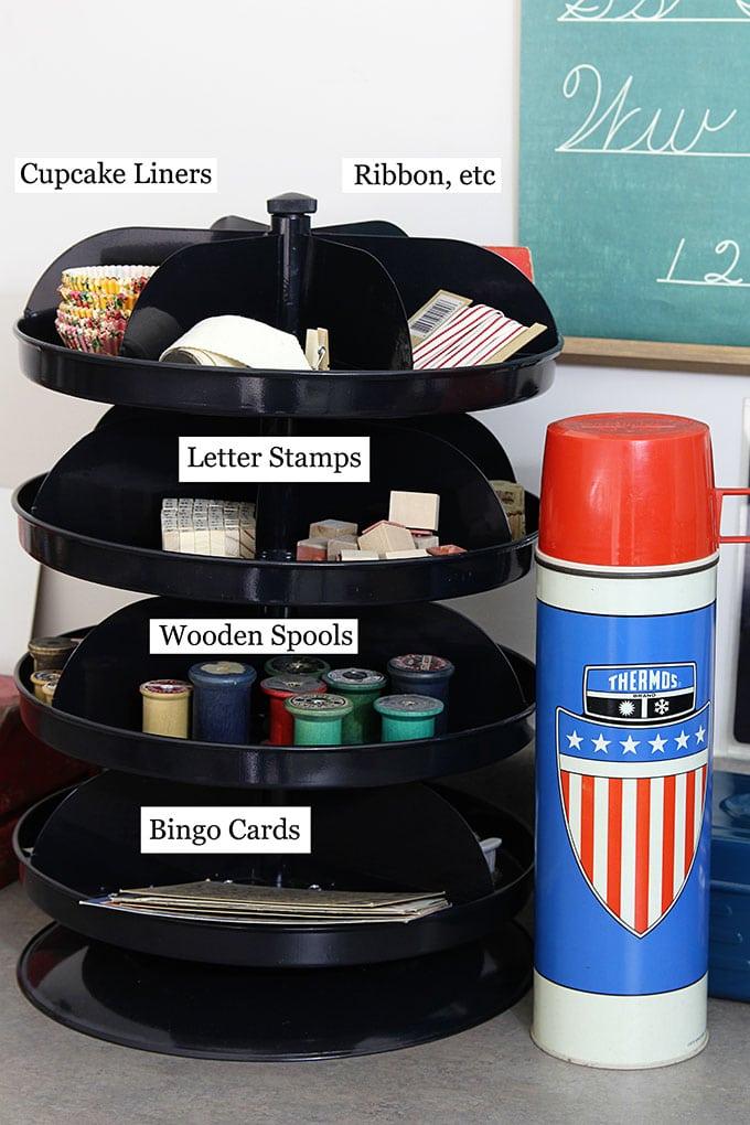 Industrial rotating bins used to organize craft supplies