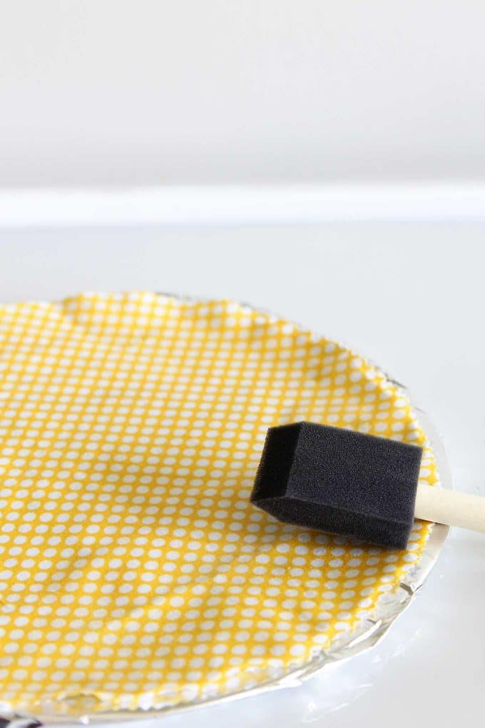 Spreading beeswax on fabric