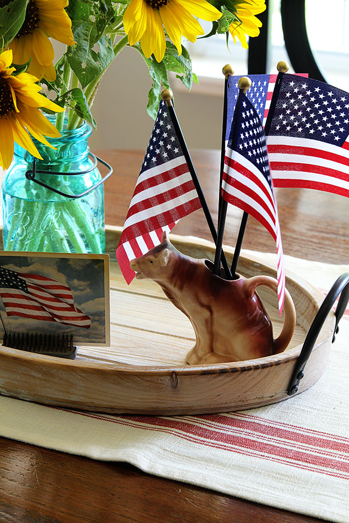 Cow creamer used in patriotic centerpiece