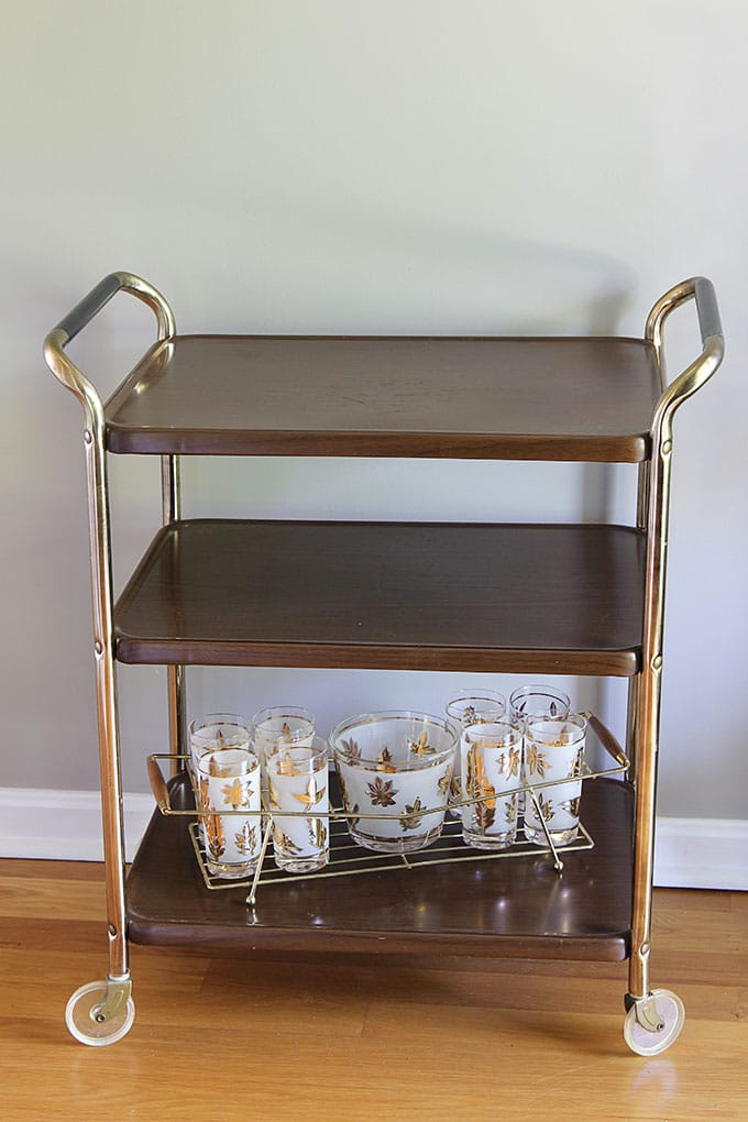 Vintage woodgrain metal kitchen cart mid-century modern design