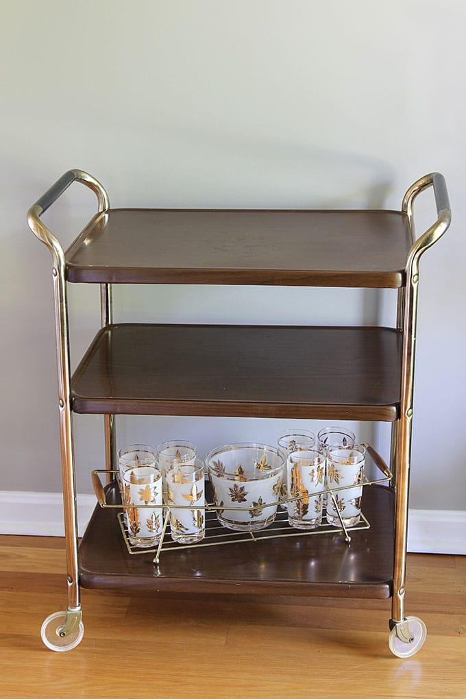 Vintage woodgrain metal kitchen cart mid-century modern design