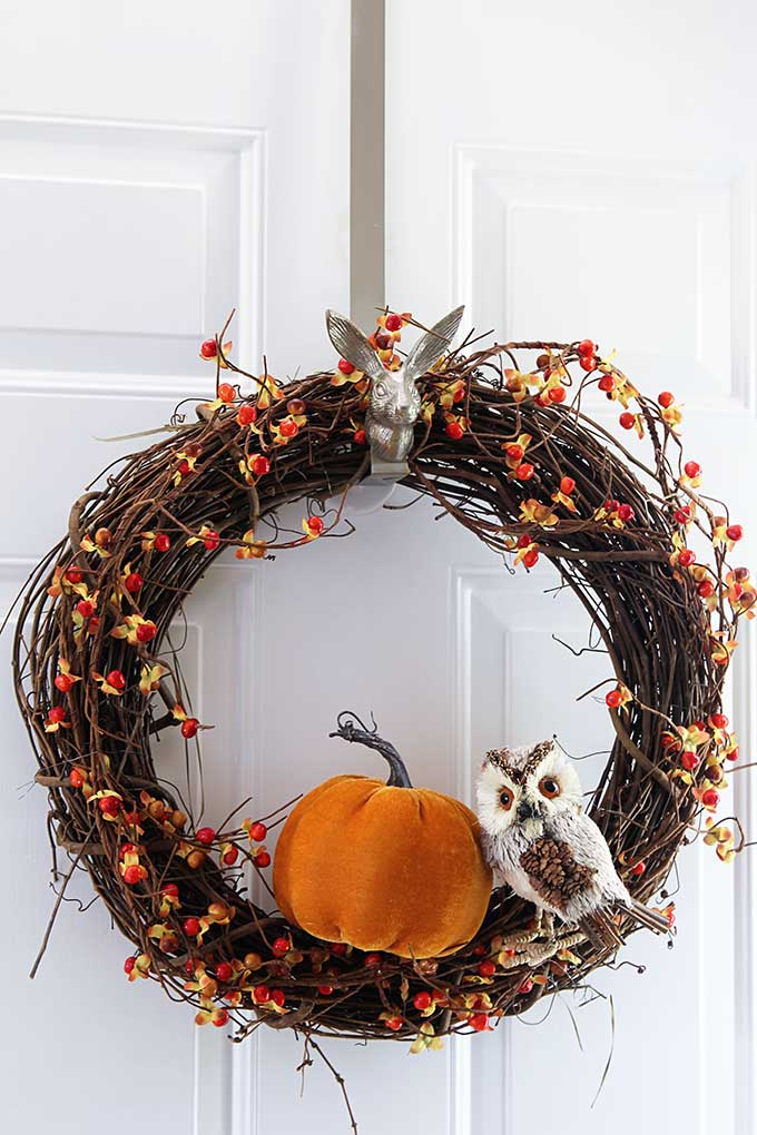 Make this quick and easy fall grapevine wreath for your front door. An inexpensive DIY project that can be done in less than 10 minutes.