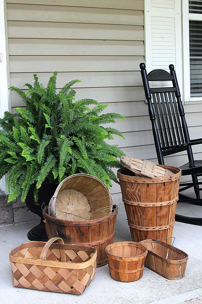 Bushel baskets are prefect to use as fall porch decor