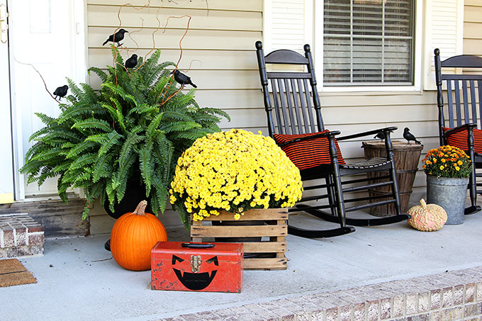 Outdoor Halloween decorations on front porch