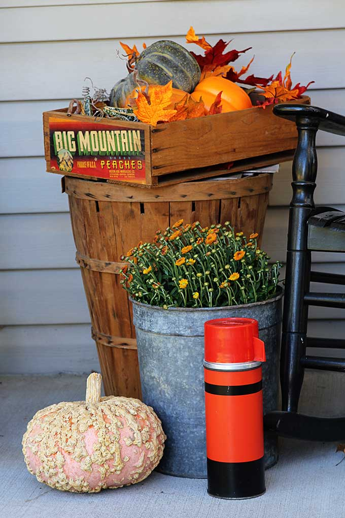 Rustic fall decor on the porch