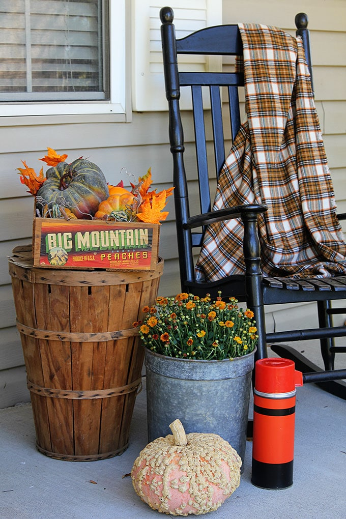 Fall on the porch with bushel baskets and rocking chairs