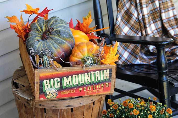 Vintage Big Mountain peach crate filled with pumpkins for fall decor
