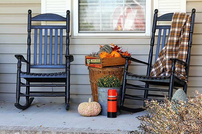 Black Rocking Chairs On The Fall Porch