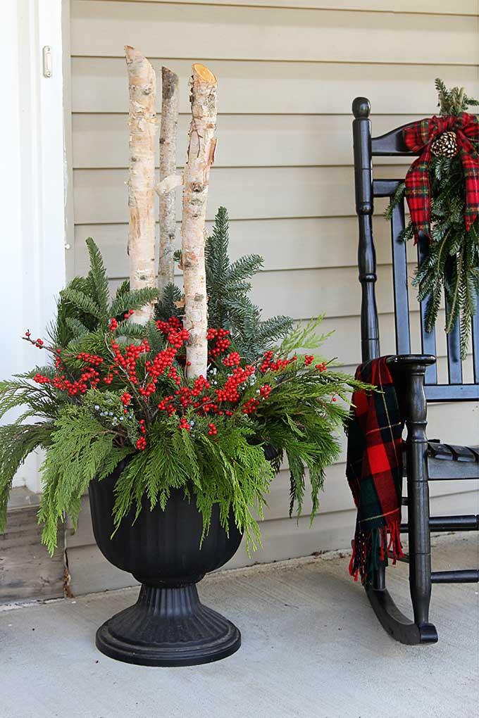 DIY outdoor Christmas planters for your holiday porch #ChristmasDecor #porch #porchdecor #containergardening #winterdecor #gardeningideas
