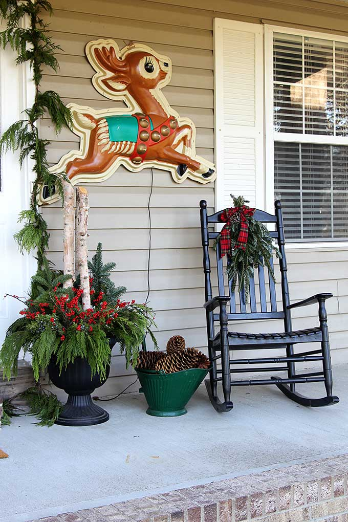 Retro store display reindeer used as holiday porch decor