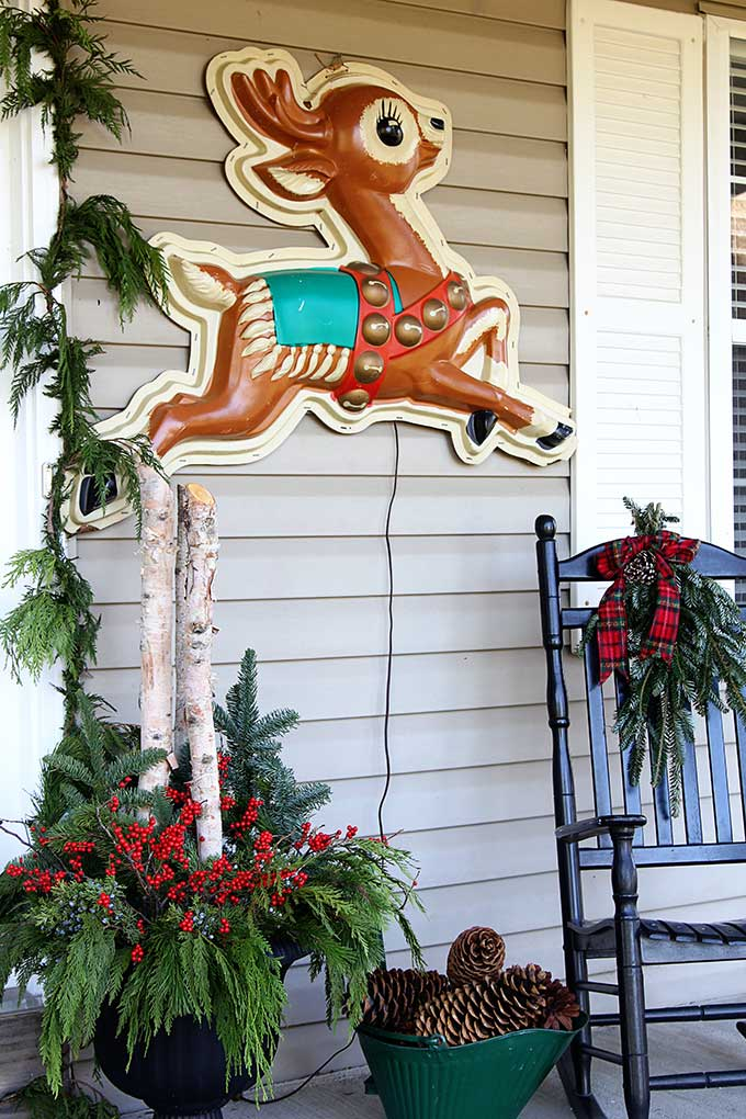 vintage store display reindeer used as front porch christmas decorations