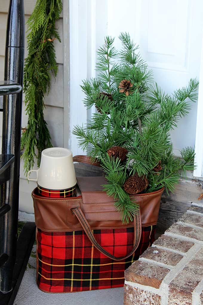 Vintage plaid Thermos picnic set used as Christmas decor
