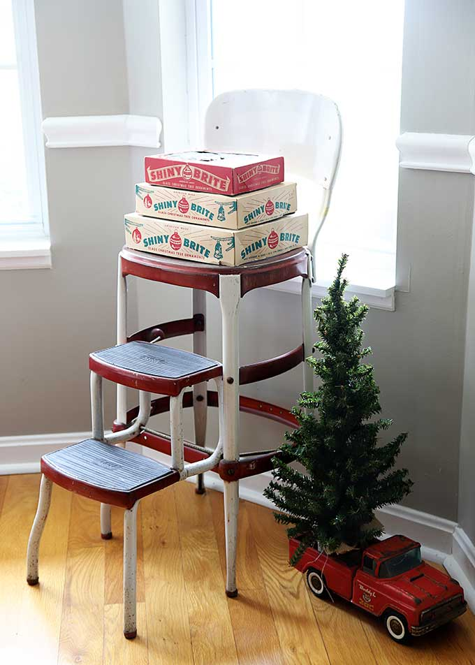 Vintage Shiny Brite boxes on a vintage Cosco step stool