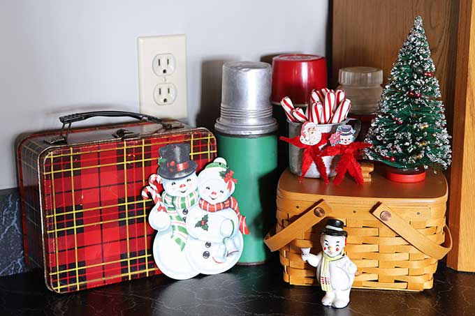 Vintage lunchboxes and thermoses used as Christmas decor