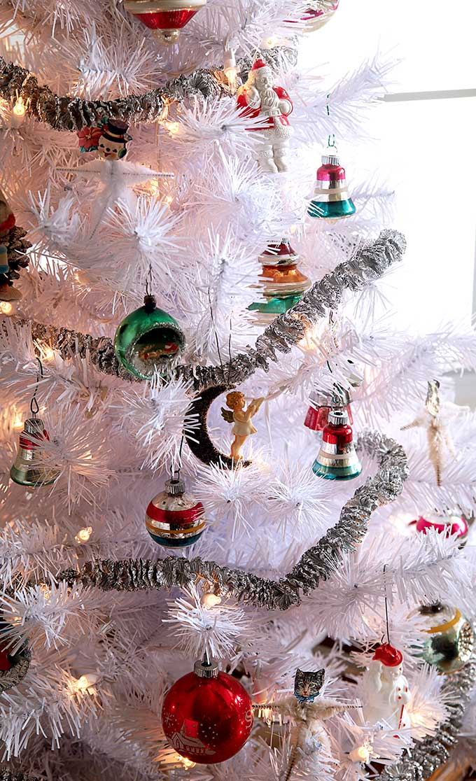 Vintage Shiny Brite ornaments on a white Christmas tree