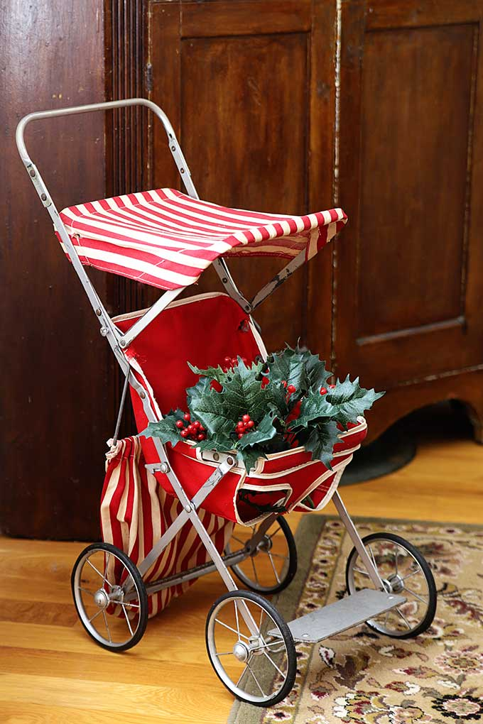 Vintage doll stroller decorated for Christmas