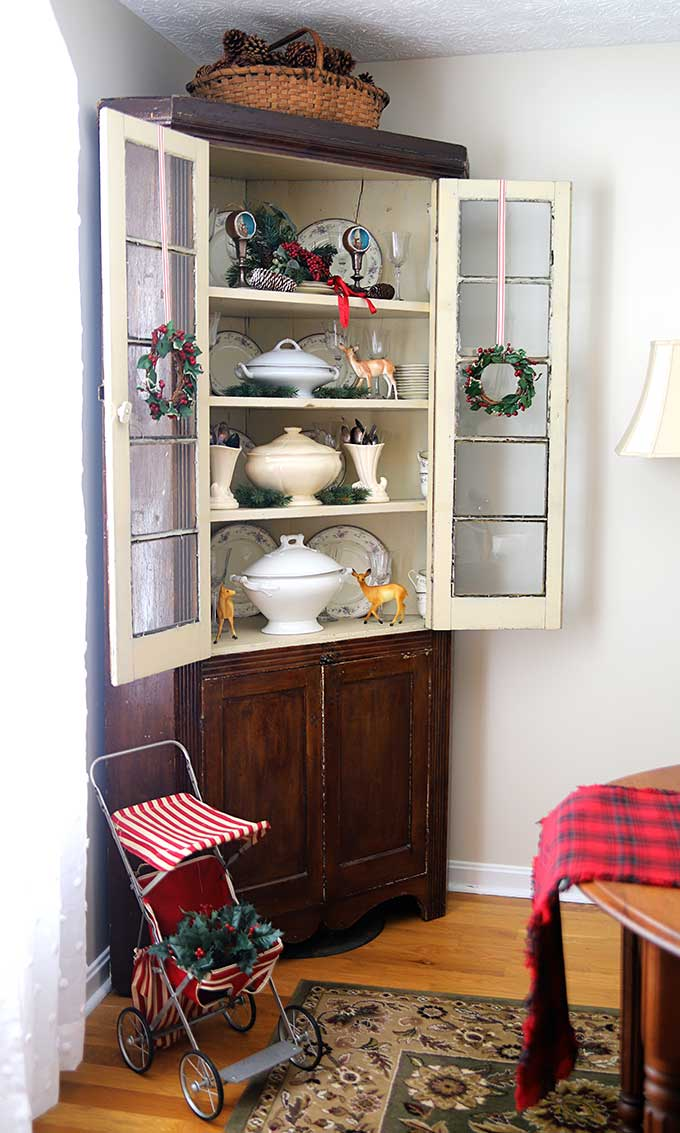 corner cabinet decorated up for christmas - Vintage Rustic Christmas Decorations