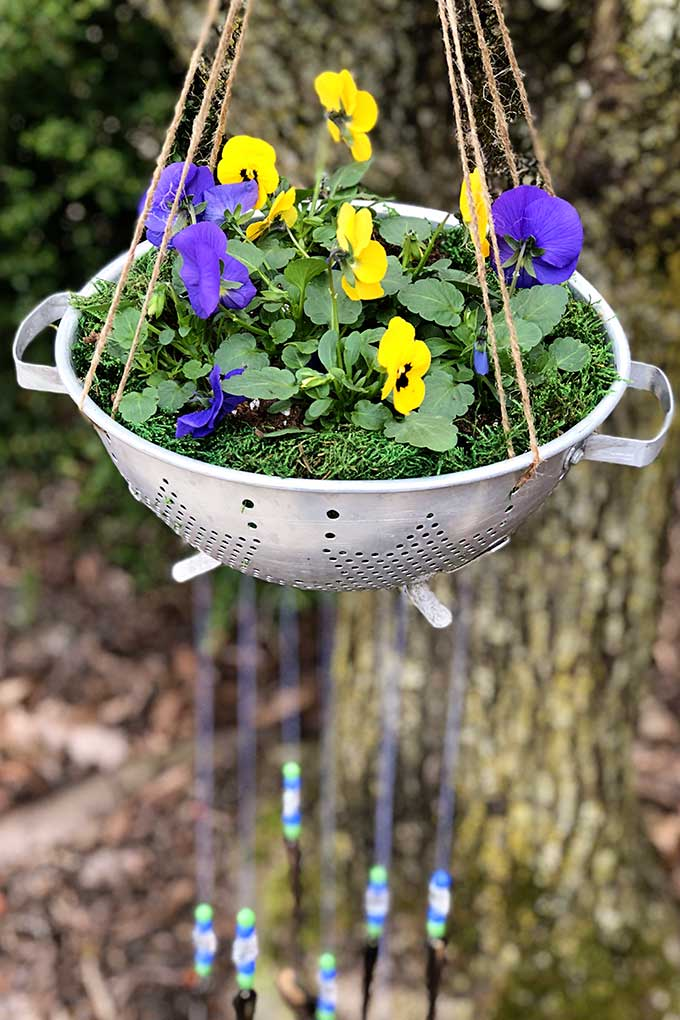 DIY silverware wind chimes with colander planter