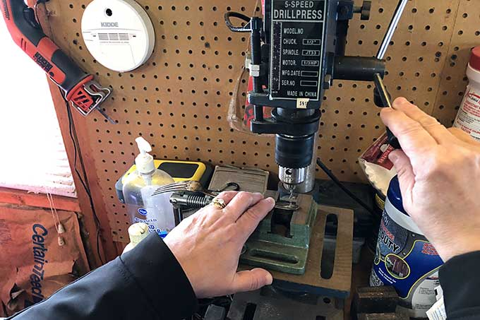Using drill press to drill hole into silverware