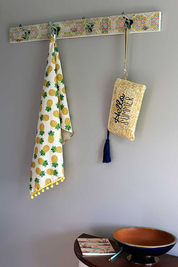 Boho style wall mounted coat rack with vintage hooks.