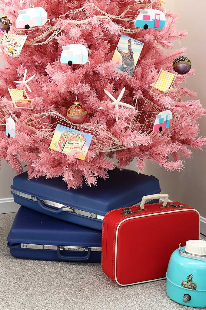 Vintage suitcases used as a unique Christmas tree stand