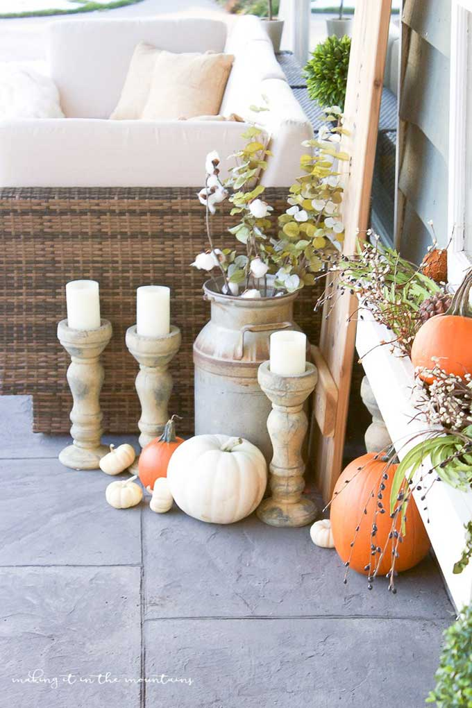 Cozy farmhouse style fall porch from Making It In The Mountains