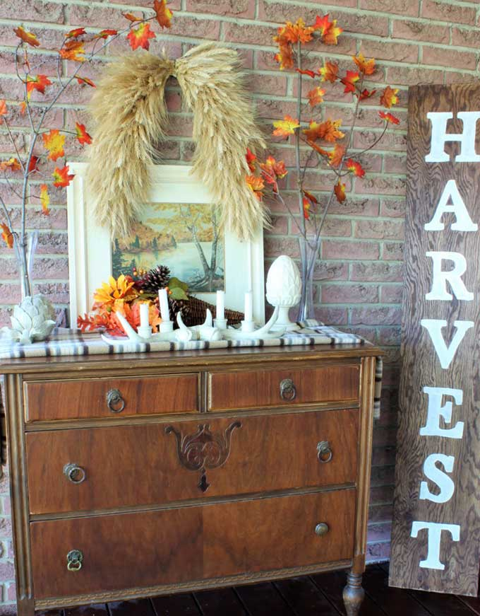 Dresser used as front porch decor for fall from A Purdy Little House