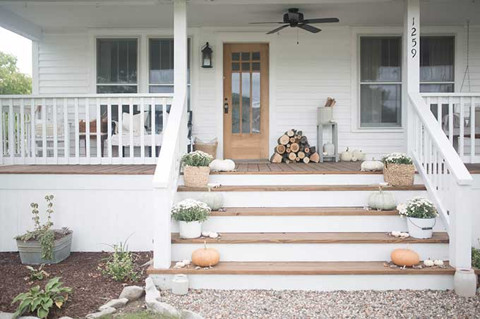 Fall farmhouse front porch decor from Farmhouse On Boone