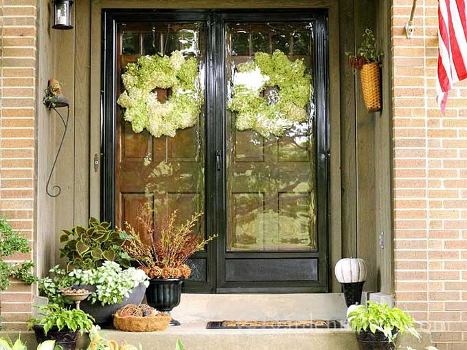 Limelight Hydrangea wreaths on a fall porch from Hearth And Vine