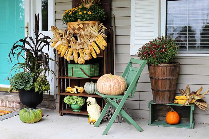 Front porch fall decor with a harvest theme.