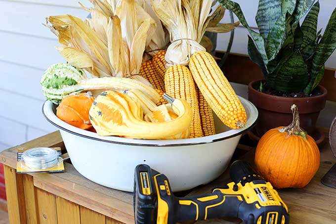 Supplies needed to make corn garland for fall decor.