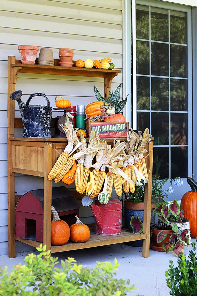 Learn how to make this harvest themed corn garland for fall decor.