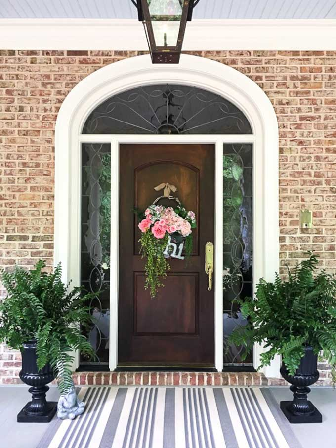 Upcycling thrift store basket into trendy door wreath