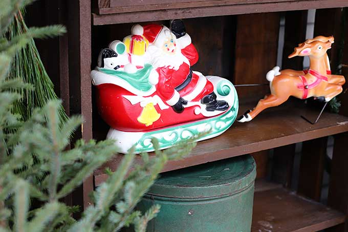 Small vintage blowmold Santa with sleigh and reindeer