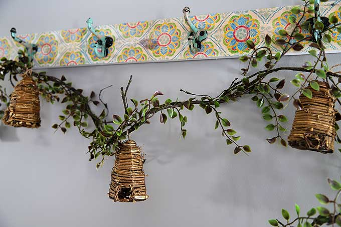 Bee skep garland on boho coat rack
