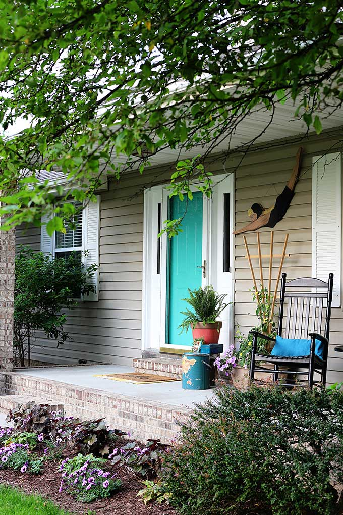 Vintage eclectic style decor for a summer front porch