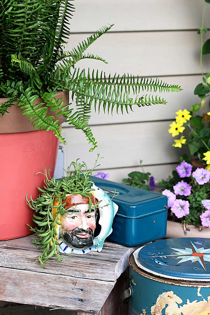 Thrift store fisherman mug repurposed into planter
