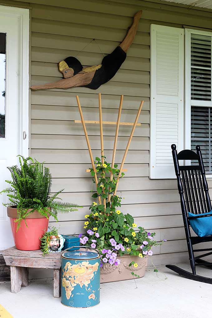 Boho style porch decor using items from the thrift store