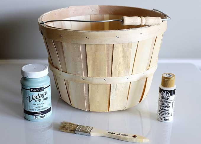 Repurposing bushel basket into outdoor planter.