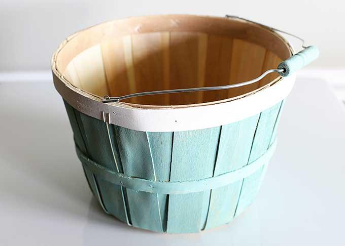 Wooden bushel basket repurposed into planter.